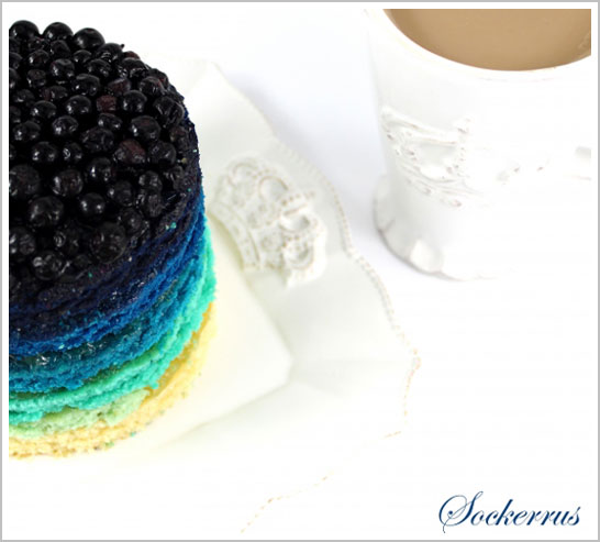 Blue Rainbow Cake, topped with blueberries