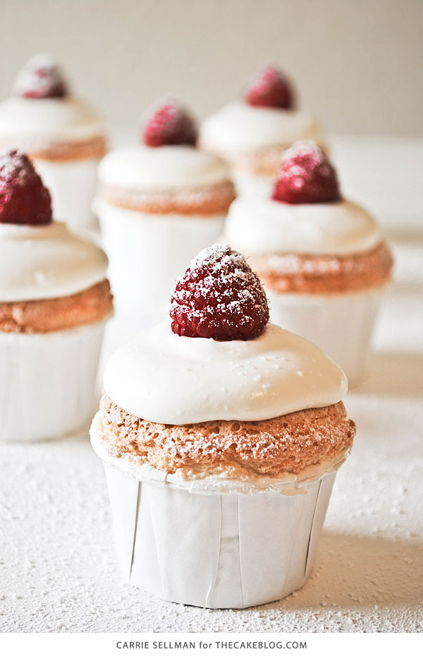 Angel Food Cupcakes with sweetened cream and raspberries | by Carrie Sellman for TheCakeBlog.com