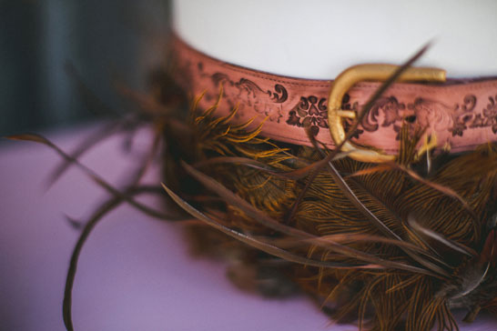 {edible} Leather Belts & Feathers Cake | by Intricate Icings | TheCakeblog.com