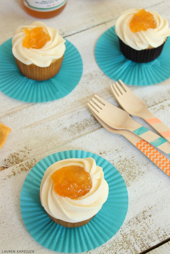 Peaches and Cream Cupcakes - fresh peach cupcakes with peach buttercream frosting | by Lauren Kapeluck for TheCakeBlog.com