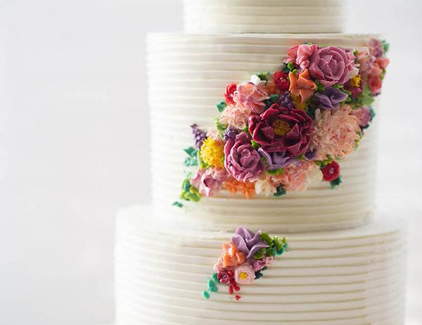 2015 Wedding Cake Trends | including this modern buttercream flower cake by Erica OBrien Cake Design | on TheCakeBlog.com