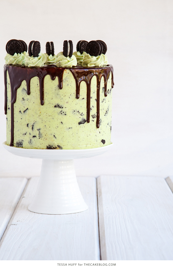 Mint Cookies 'N Cream Cake with crushed cookies in the cake and frosting plus a chocolate drip | by Tessa Huff for TheCakeBlog.com