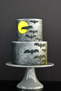 Learn how to make this Spooky Splatter Halloween Cake with flying bats | by Erin Gardner for TheCakeBlog.com