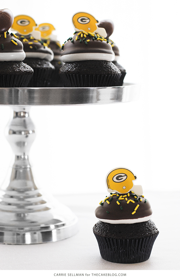 NFL Game Day Cupcakes | chocolate cupcakes with fluffy marshmallow frosting and dipped in chocolate. Perfect for football tailgating and homegating.