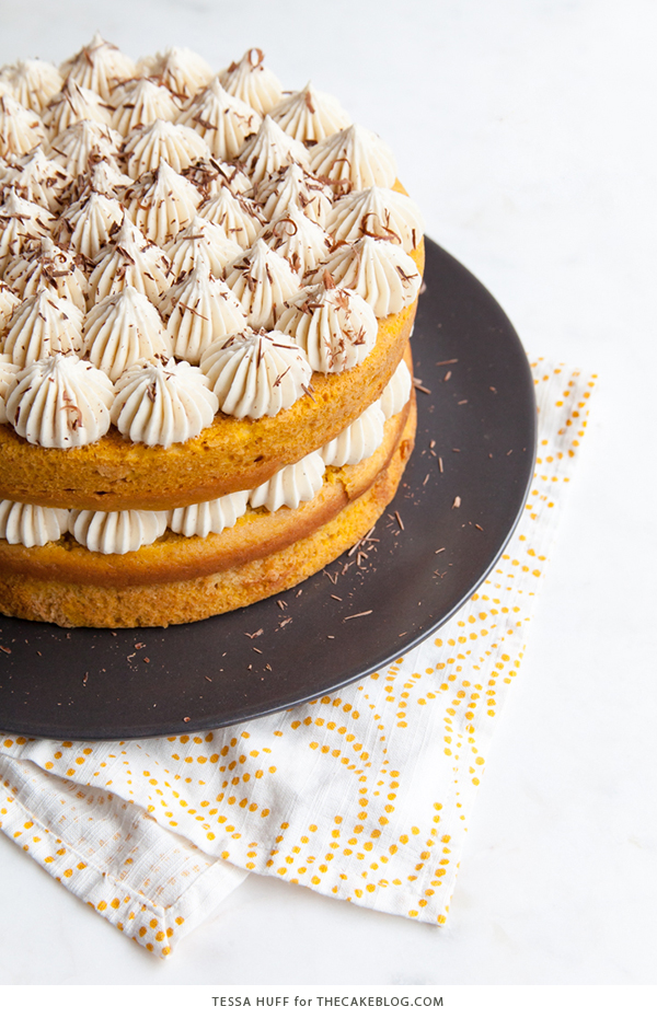 Pumpkin Tiramisu Cake - pumpkin spice cake soaked with coffee liqueur, fluffy mascarpone frosting and chocolate shavings | Tessa Huff for TheCakeBlog.com