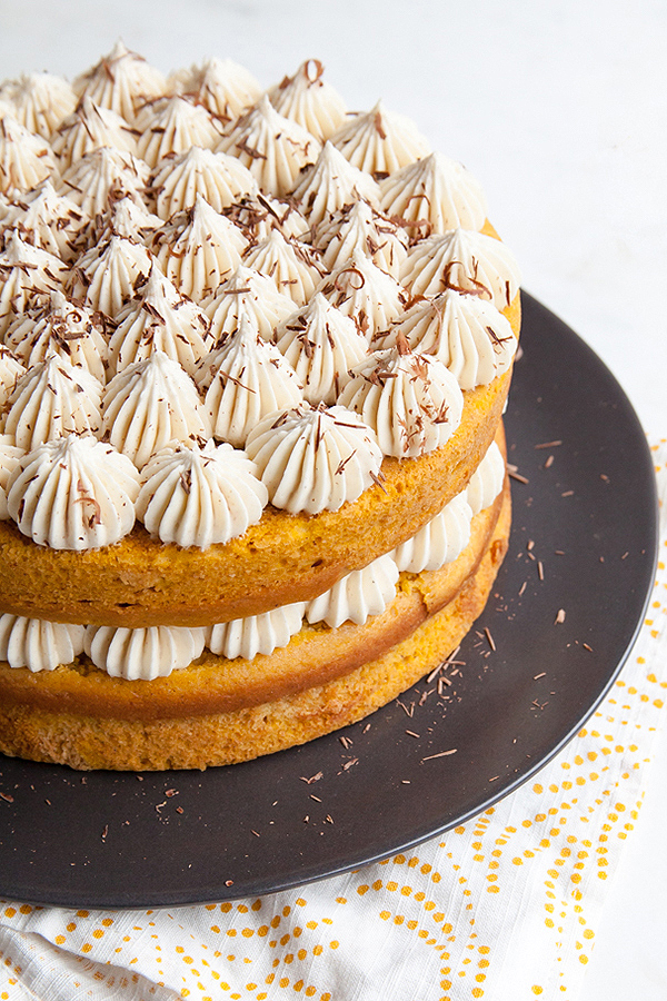 Pumpkin Tiramisu Cake. Pumpkin cake soaked with coffee liqueur, layered with mascarpone frosting and chocolate shavings | Tessa Huff for TheCakeBlog.com