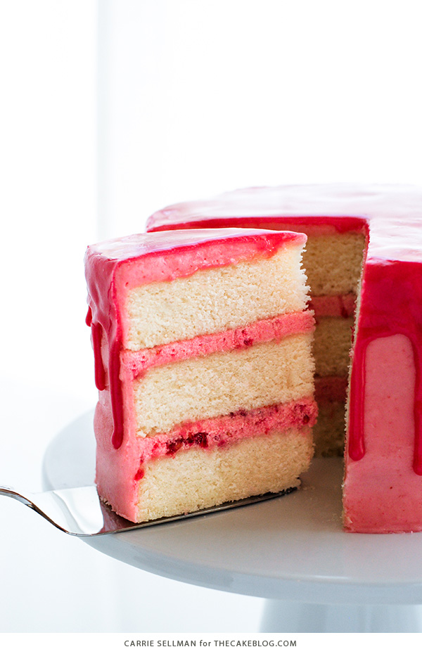 Raspberry Champagne Cake with raspberry drip glaze and fresh raspberries | by Carrie Sellman for TheCakeBlog.com