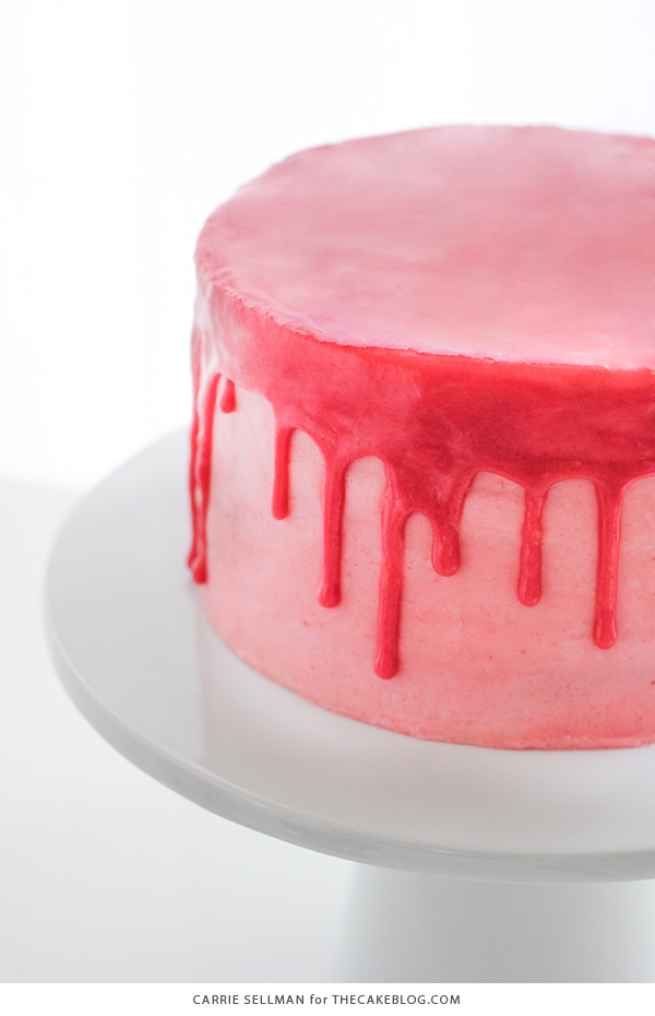 Raspberry Champagne Cake with raspberry drip glaze and fresh raspberries   by Carrie Sellman for TheCakeBlog.com
