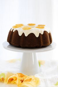 Candied Lemon Cake - a lemon cream cheese bundt cake topped with lemon cream cheese frosting and candied lemon slices | By Carrie Sellman for TheCakeBlog.com