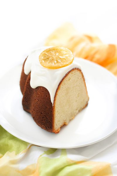 Lemon Bundt Cake - easy lemon pound cake recipe with a relaxed cream cheese glaze and candied lemon slices | By Carrie Sellman for TheCakeBlog.com