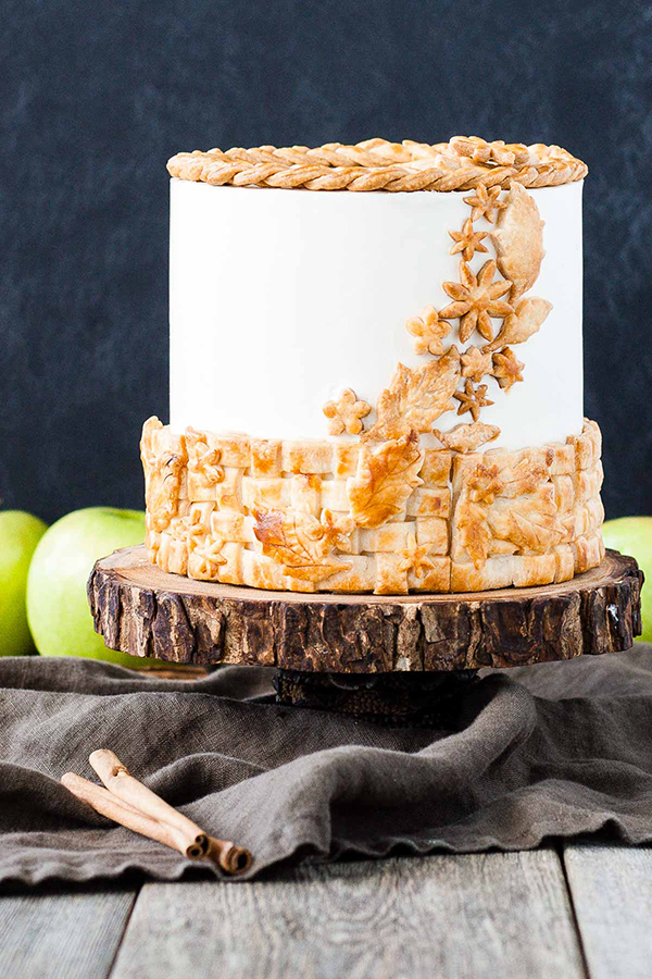 Apple Pie Cake!  A layer cake recipe with hints of cinnamon and nutmeg, fresh apple pie filling, buttercream frosting and braided pie crust lattice | by Olivia Bogacki for TheCakeBlog.com