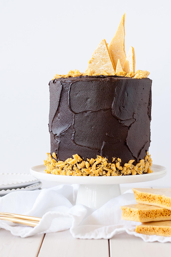 Dark Dark Chocolate Honeycomb Cake - a rich chocolate layer cake recipe with ultra dark, fudgy frosting and homemade honeycomb | by Olivia Bogacki for TheCakeBlog.com