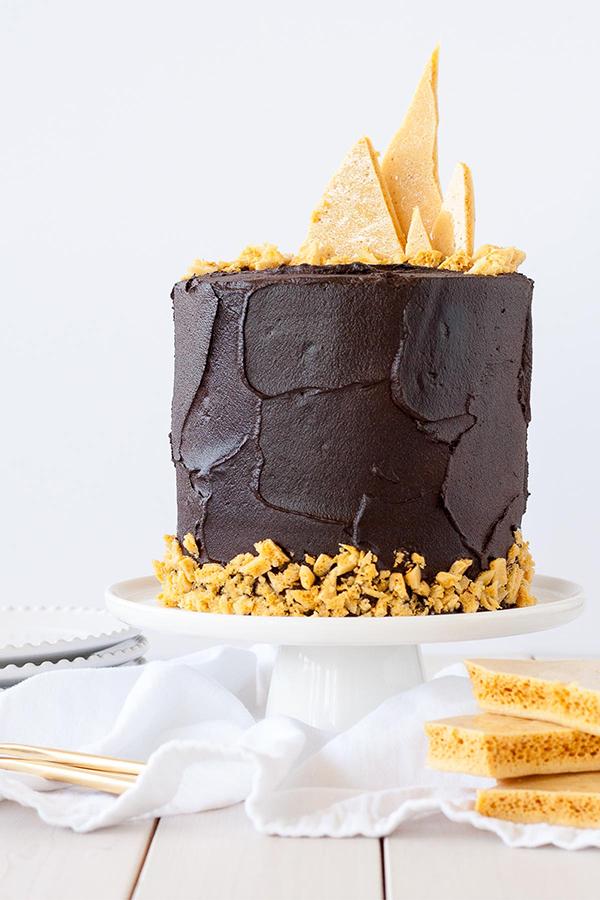 Dark Dark Chocolate Honeycomb Cake - a rich chocolate layer cake recipe with ultra dark, fudgy frosting and homemade honeycomb | by Olivia Bogacki for TheCakeBlog.com