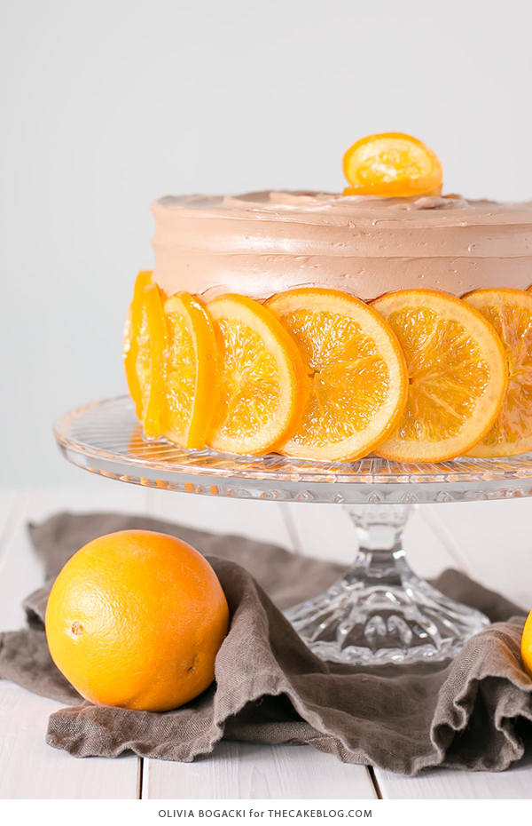 Chocolate Orange Cake - layer cake infused with orange zest and orange syrup, topped with chocolate frosting and candied orange slices | By Olivia Bogacki for TheCakeBlog.com