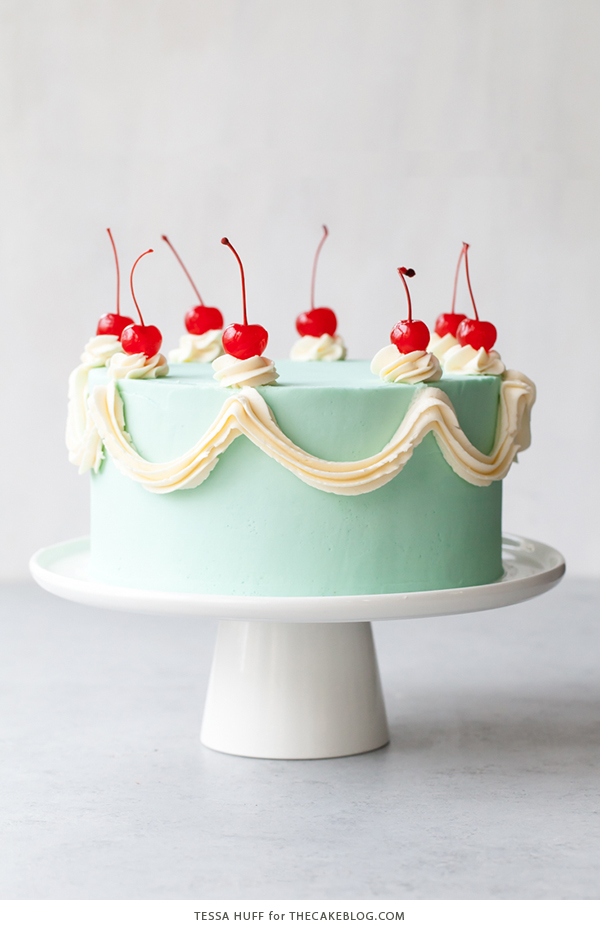 Cherry Chip Cake - maraschino cherry cake studded with chocolate chips, layered with chocolate ganache and finished with a whipped vanilla buttercream frosting | by Tessa Huff for TheCakeBlog.com