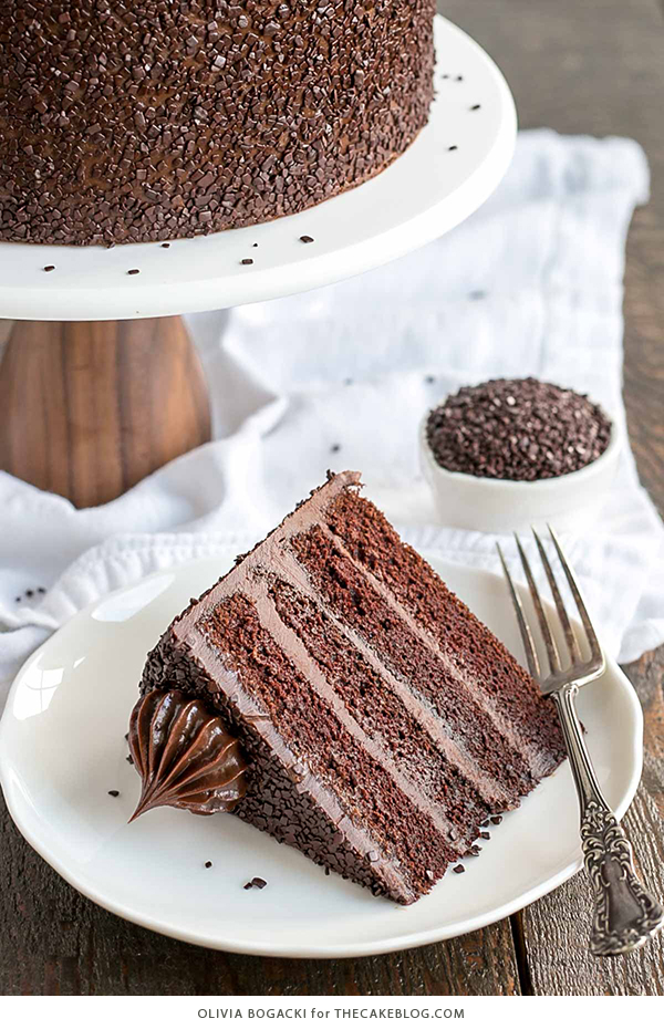 Chocolate Truffle Cake - a chocolate layer cake recipe with dense, moist chocolate cake, silky chocolate truffle frosting and chocolate flakes | by Olivia Bogacki for TheCakeBlog.com