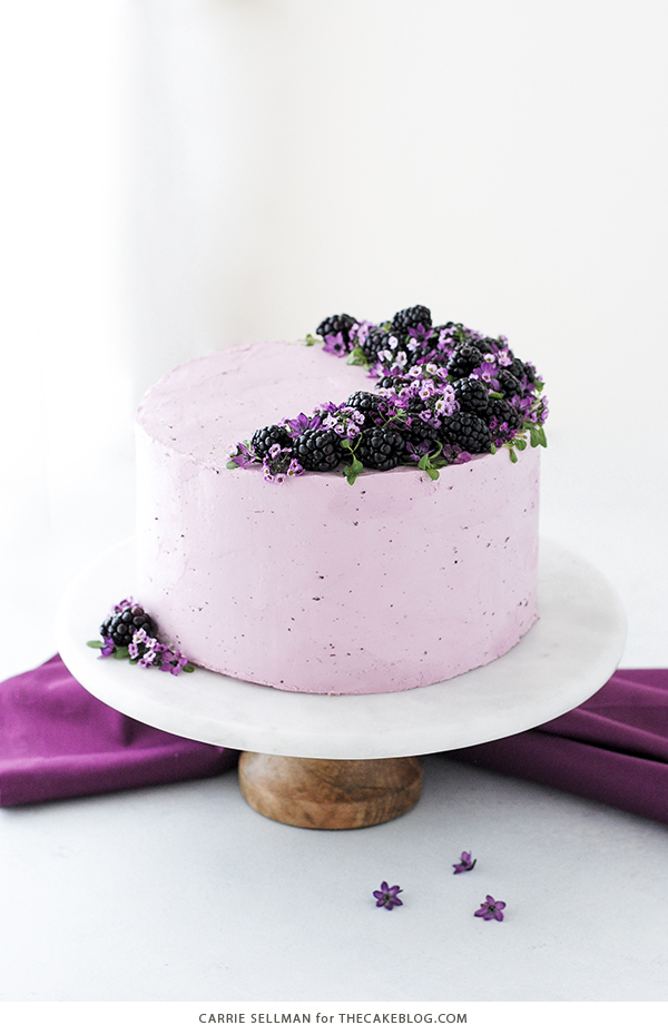 Blackberry Lime Cake - tender cake infused with lime zest, frosted with blackberry buttercream, topped with fresh blackberries and edible flowers | by Carrie Sellman for TheCakeBlog.com