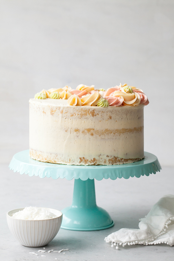 Coconut Cake - homemade coconut cake with creamy coconut milk, brushed with coconut syrup to keep it extra moist, and topped with vanilla bean buttercream frosting | by Tessa Huff for TheCakeBlog.com