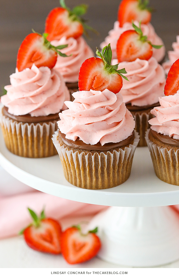 Strawberry Nutella Cupcakes with a soft, fluffy Nutella cupcake topped with more Nutella and a fresh strawberry frosting | by Lindsay Conchar for TheCakeBlog.com