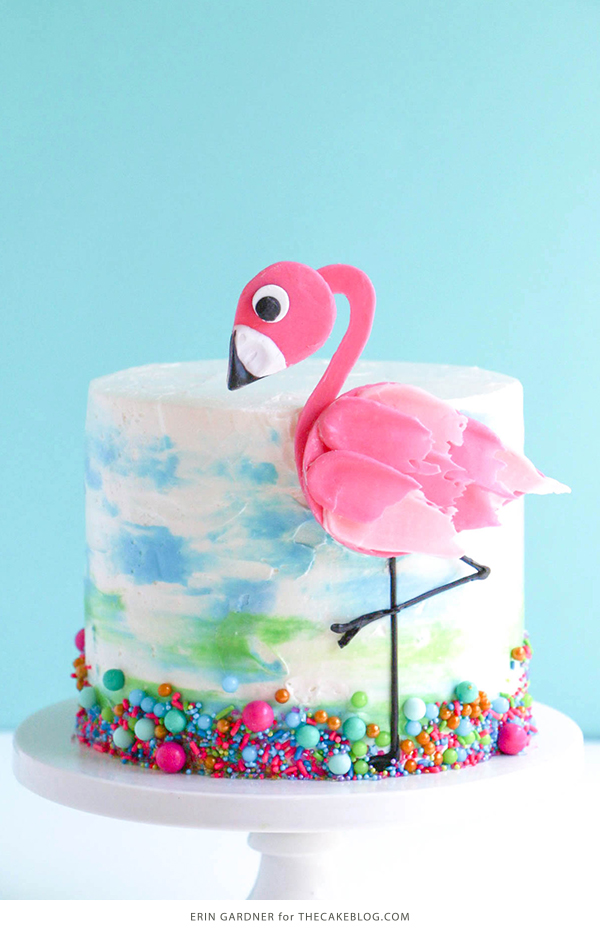 Flamingo Cake - how to make a pink flamingo cake topper using chocolate candy melts and brushstroke feathers | by Erin Gardner for TheCakeBlog.com