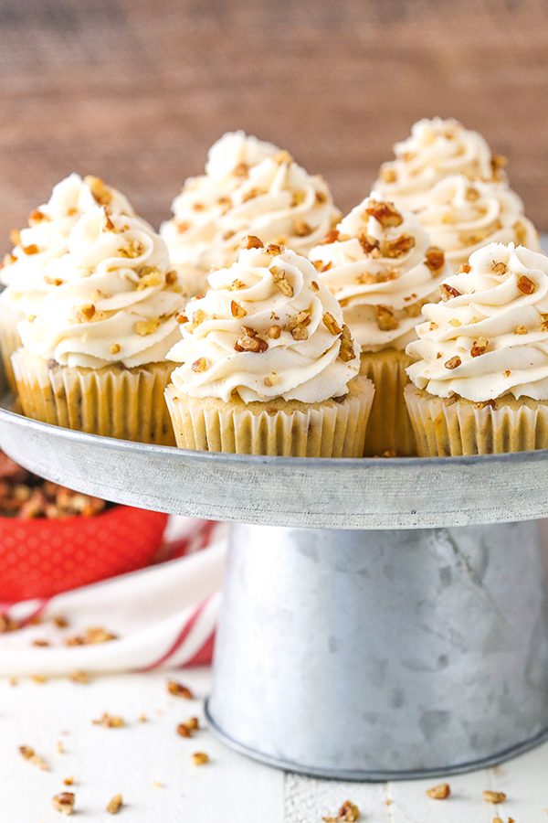 Butter Pecan Cupcakes - moist vanilla cupcakes studded with toasted butter pecans and topped with cinnamon buttercream frosting | by Lindsay Conchar for TheCakeBlog.com