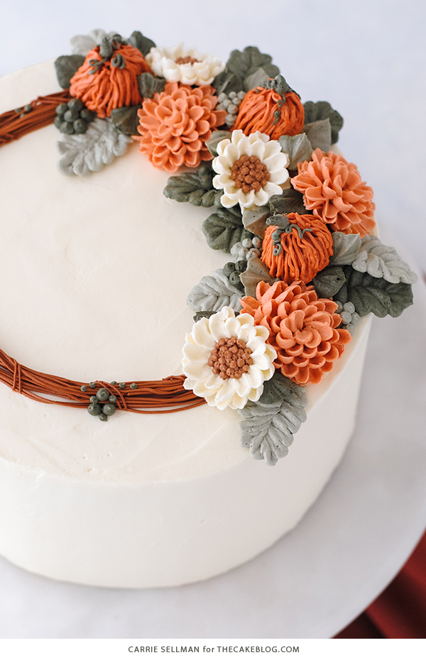 Pumpkin Spice Cake - moist pumpkin cake with cinnamon, ginger and nutmeg paired with pumpkin spice buttercream frosting | by Carrie Sellman for TheCakeBlog.com