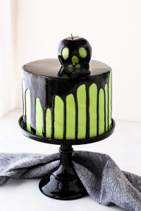 "Poison Apple Cake - a black mirror glaze cake with an edible ""poison apple"" for Halloween 