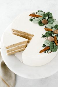 Eggnog Cake - a rich butter cake with hints of cinnamon and nutmeg, paired with a creamy eggnog buttercream | by Carrie Sellman for TheCakeBlog.com