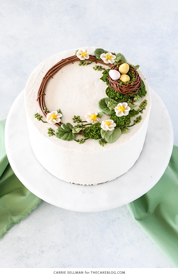 Spring Wreath Cake - how to make a buttercream wreath cake a bird's nest, cherry blossoms, green berries and cookie moss | by Carrie Sellman for TheCakeBlog.com #easter #easterdinnerideas #mothersday #cake