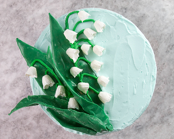 Chocolate Lilies - how to make Lily of the Valley cake decorations with chocolate | by Erin Gardner for TheCakeBlog.com