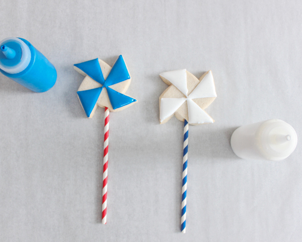 Pinwheel Cookies -- red, white and blue pinwheel cookies on a stick | by ellenJAY for TheCakeBlog.com