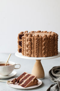 Chocolate Toffee Crunch Cake - fudge chocolate cake lightly spiced with cinnamon paired with crunchy toffee bits and silky smooth chocolate buttercream frosting | by Tessa Huff for TheCakeBlog.com