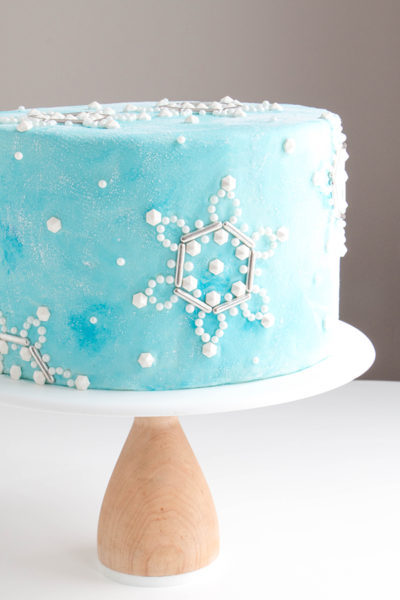 Sueded Buttercream Cake with Sprinkle Snowflakes | by Erin Gardner for TheCakeBlog.com